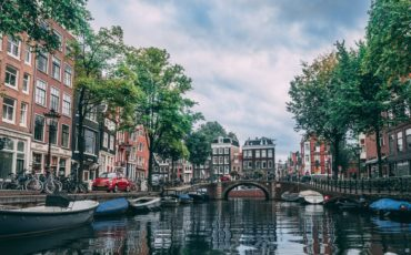 Which 5 star hotels are in Amsterdam city centre near canal ring Red Light District museums Dam Square Central Train Station